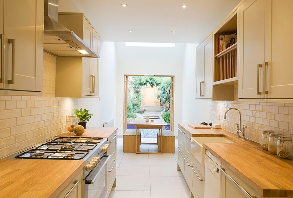 How to make a small kitchen look bigger a very cozy home for Narrow kitchen plans