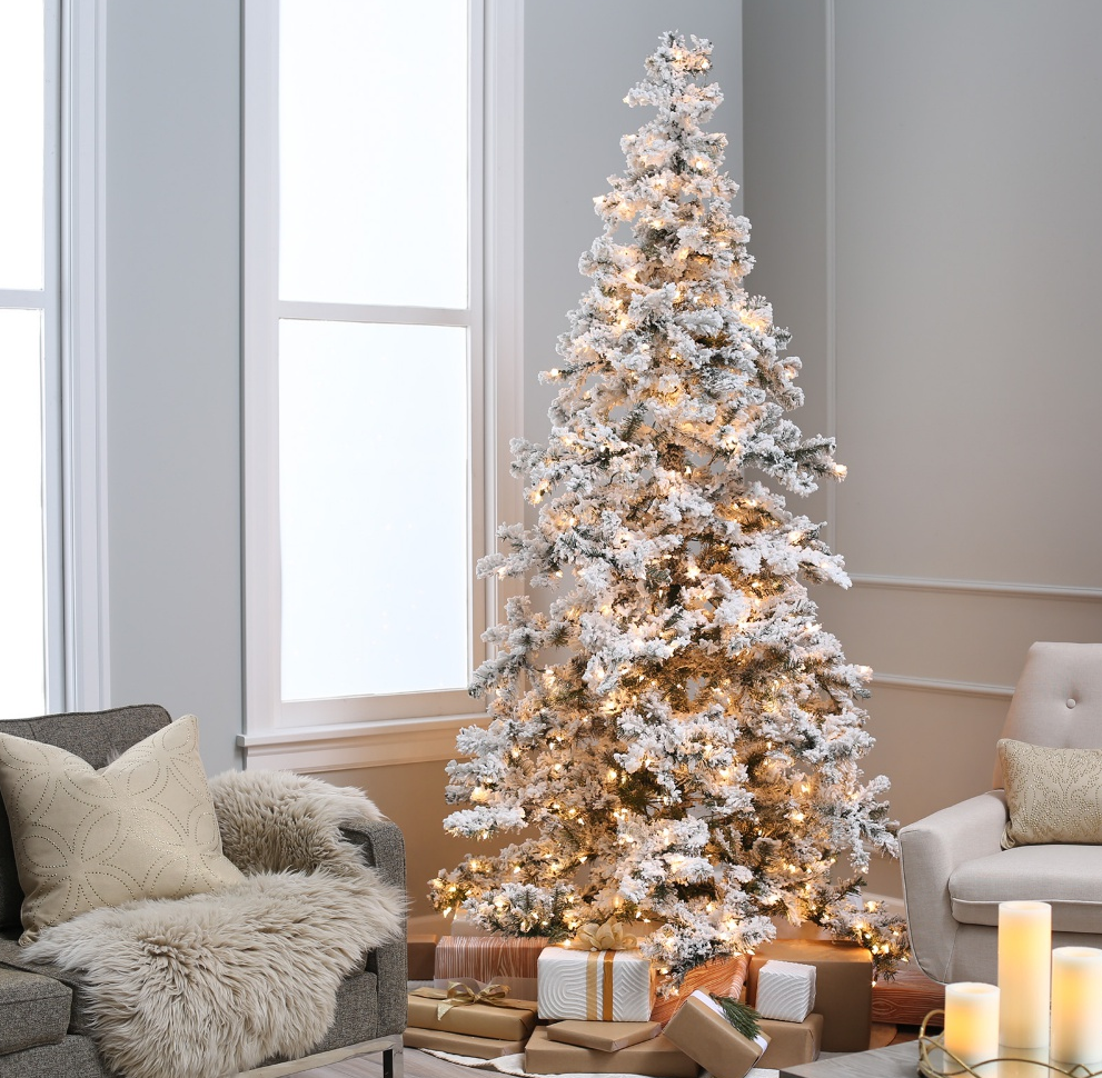 when it comes to christmas trees there is no better looking tree right out of a winter tale than a flocked christmas tree flocking refers to artificial - Decorated Flocked Christmas Trees