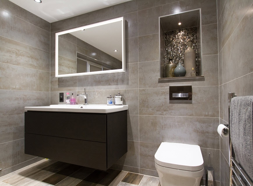 ensuite with brown wall tiles and furniture and white accents
