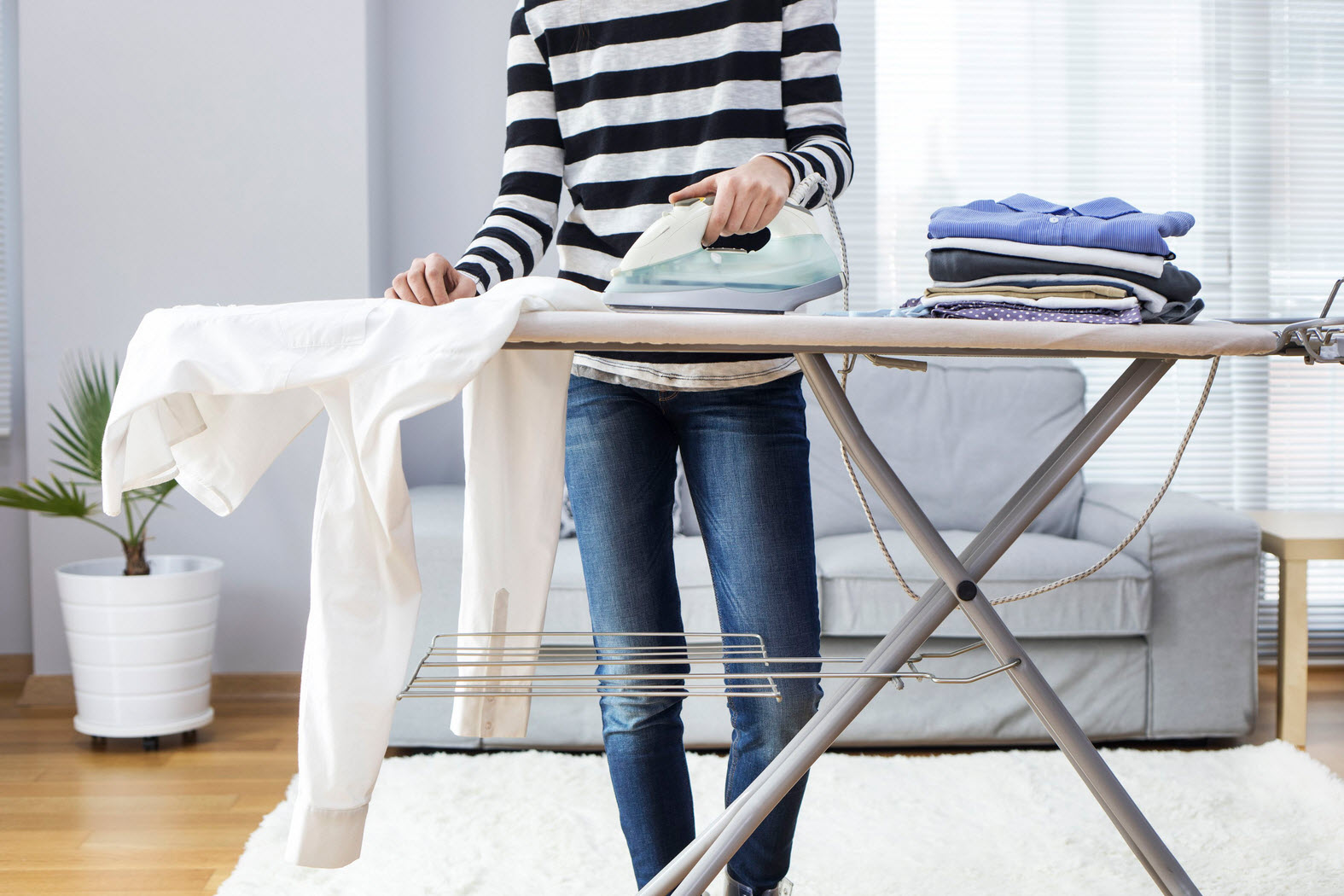 woman ironing on board