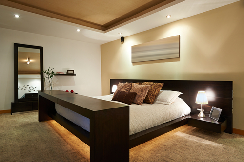 modern bedroom at night with discreet hidden lighting