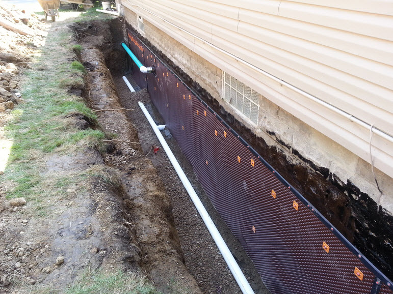 basement wall preparation on the outside of the house