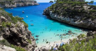 mallorca beach blue clear water rocky gulf forest