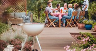 family on patio chairs around table