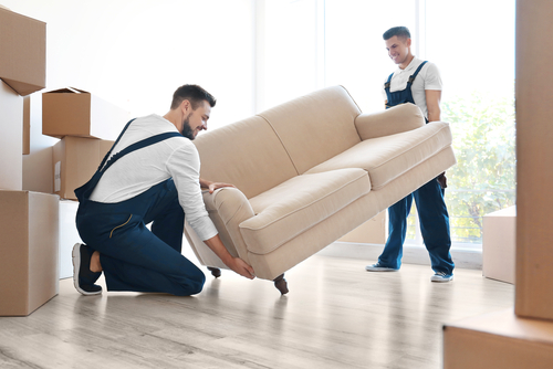 two movers with sofa