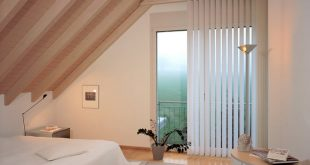 vertical blinds in attic bedroom