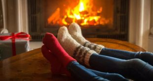 winter night socks in feet by fireplace