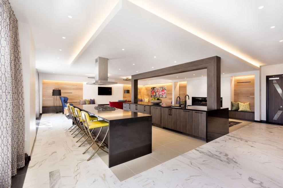 a-long-kitchen-island-with-a-quartz-marble-top