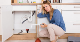 housewife getting headaches because of plumbing problems