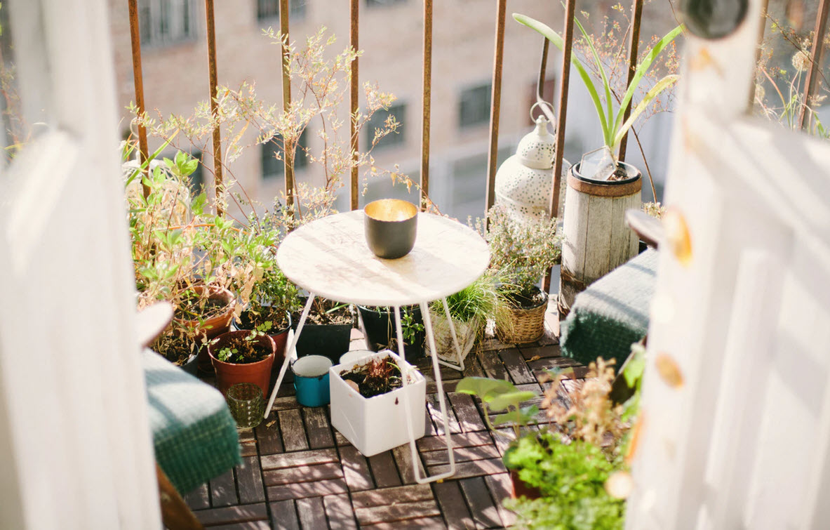 colorful balcony with plant pots and furniture