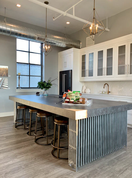 grey industrial style kitchen with white cabinets