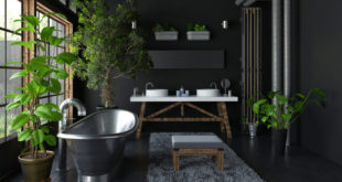 industrial style bathroom with metal tub and plants