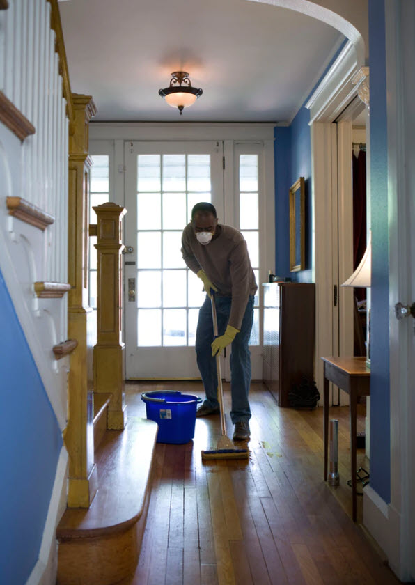 professional cleaning entry hallway hardwood floor in home