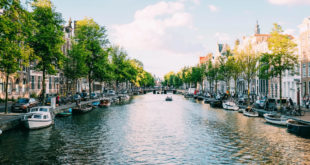 canal with boats in amsterdam