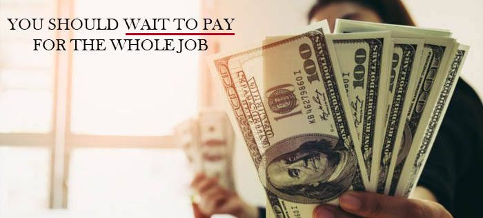 You should wait to pay for the whole job