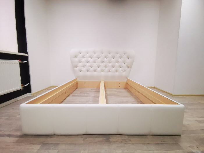 new bed in empty room