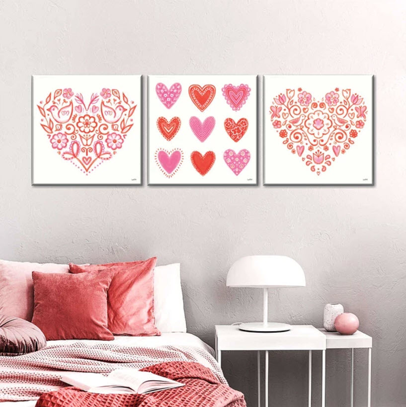 series of three heart shaped pink paintings